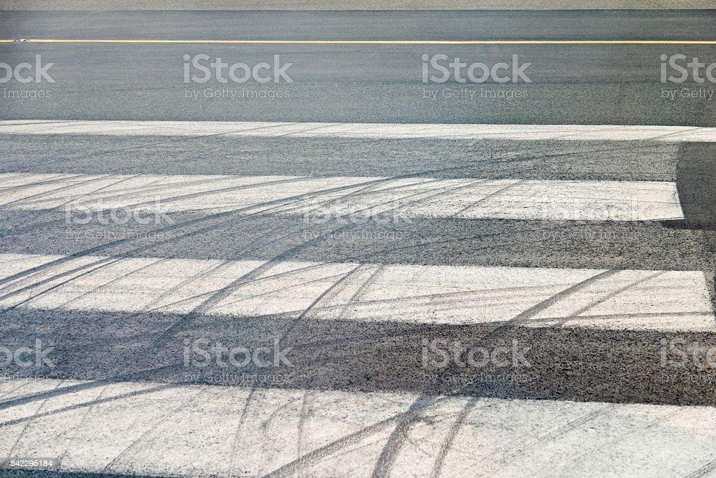 Tire track on zebra crossing stock photo