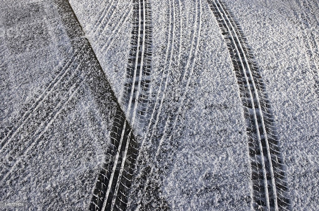 tire tracks in fresh snow stock photo