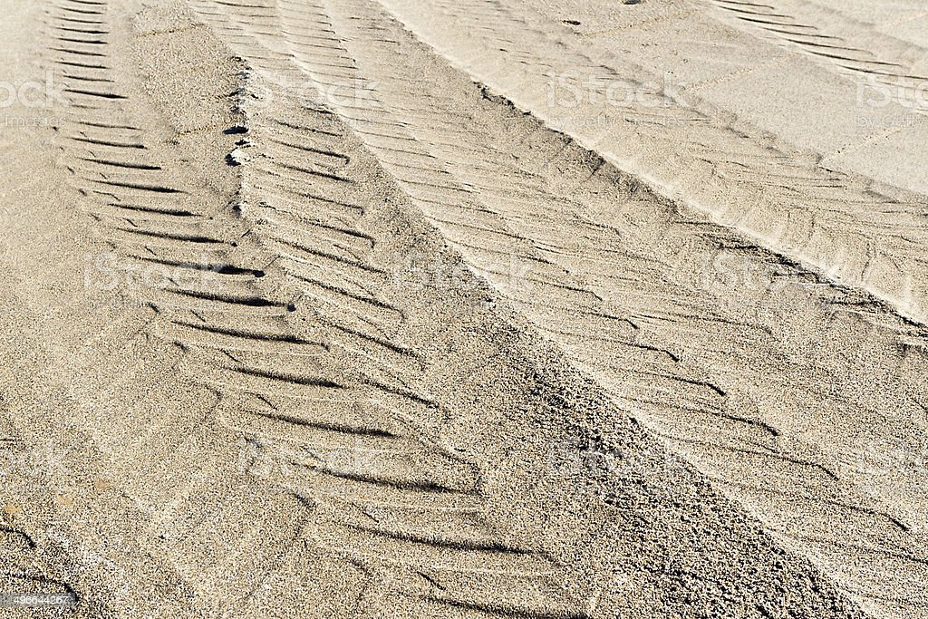 Tire tracks in sand stock photo
