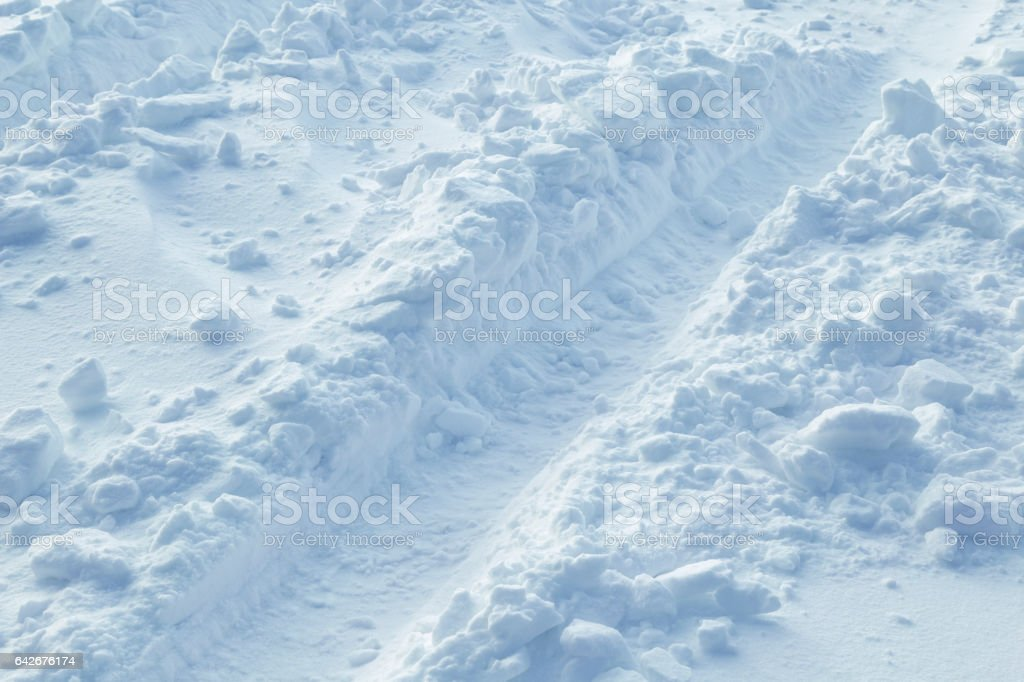 Tire Tracks in Snowdrifted Country Road stock photo