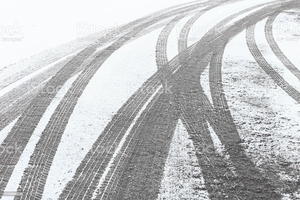 Tire tracks in the fresh snow stock photo