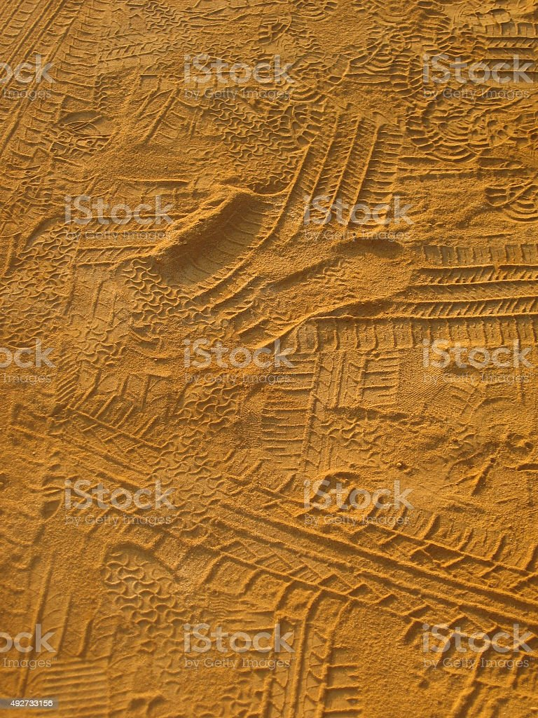 Tire tracks in the sand royalty-free stock photo