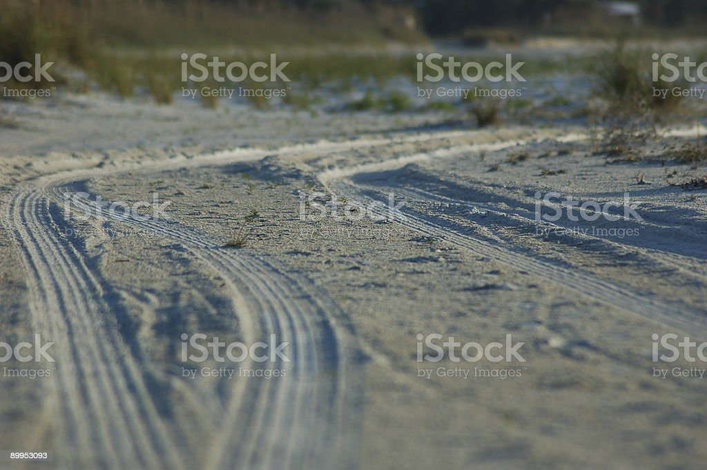 Tire tracks on beach royalty-free stock photo