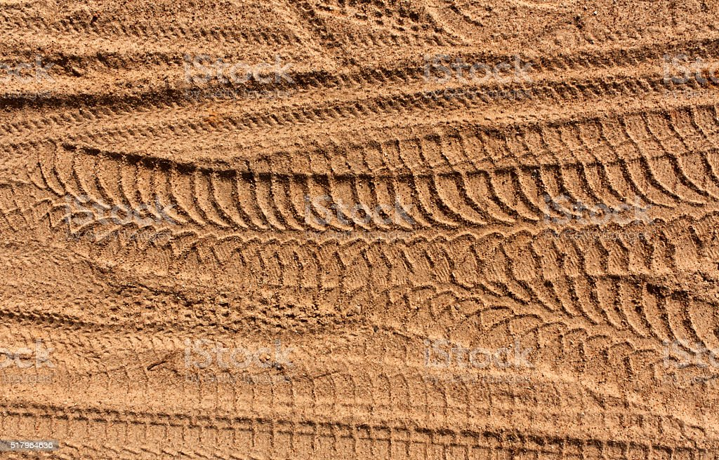 Tire tracks on sand. stock photo