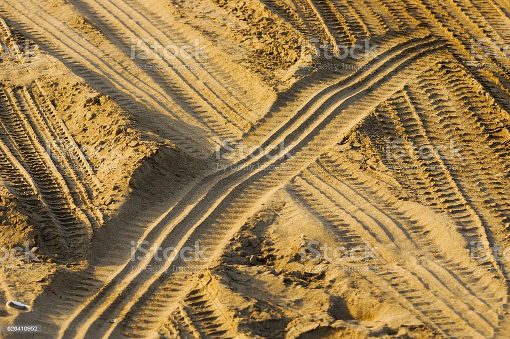 tire tracks on the sand stock photo