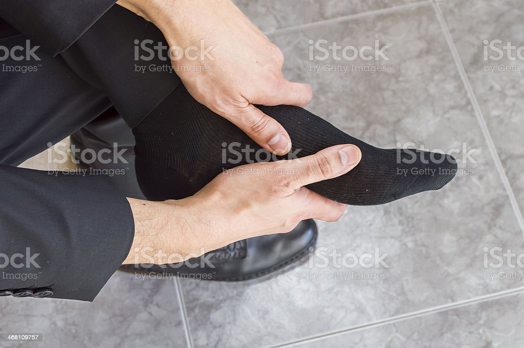 tired and aching feet stock photo