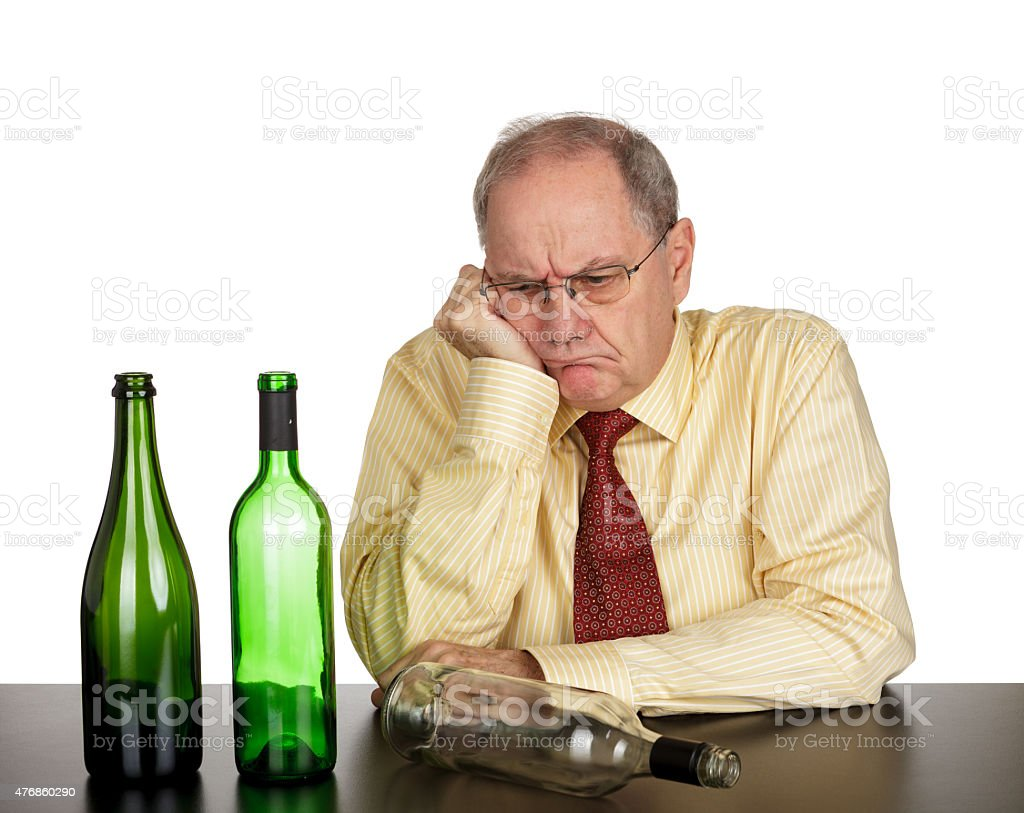 Tired and drunk businessman stock photo