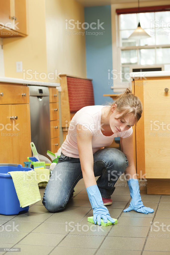 Tired and Exhausted Woman Spring Cleaning Washing Floor in Kitchen royalty-free stock photo