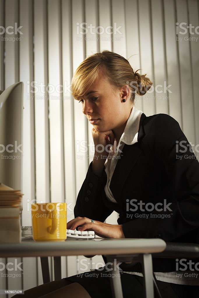 Tired and Exhausted Young Business Woman Working Late in Office royalty-free stock photo
