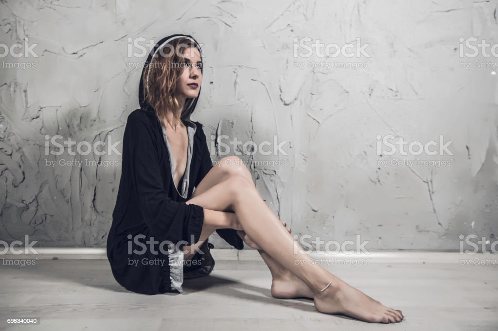Tired and sexy woman stock photo