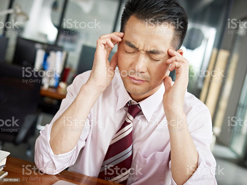 tired asian business person stock photo