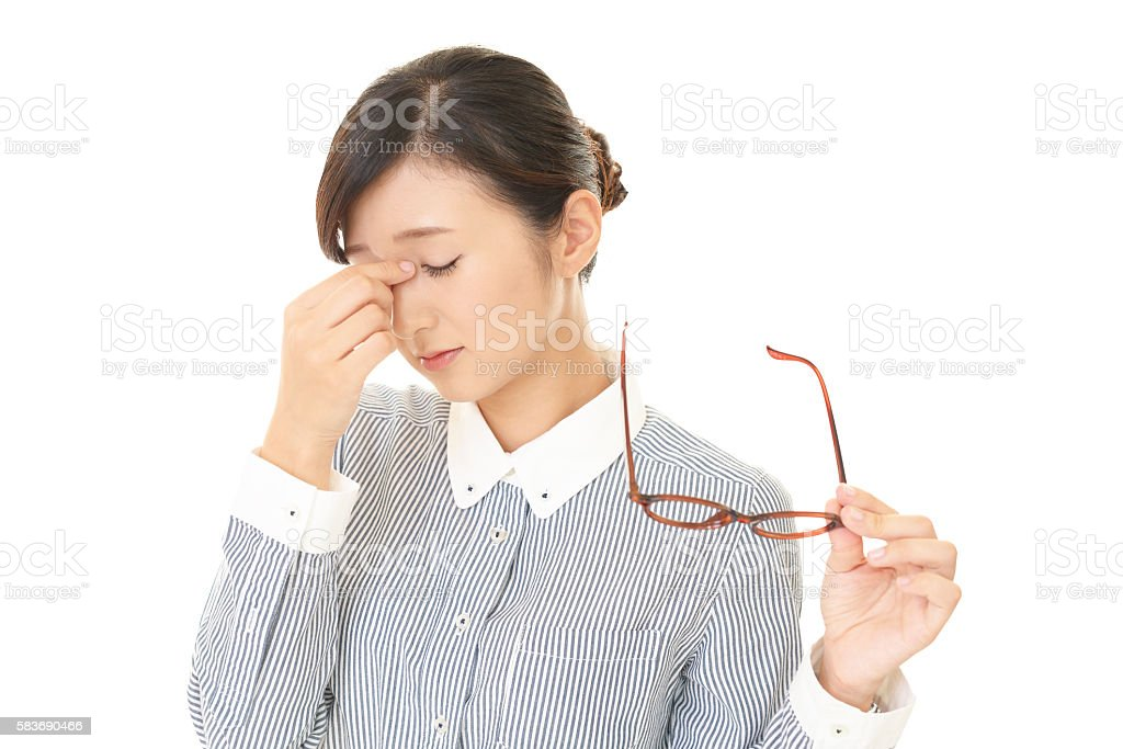 Tired Asian business woman stock photo
