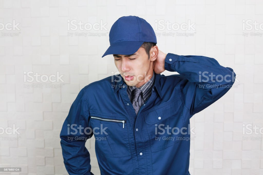 Tired Asian worker stock photo