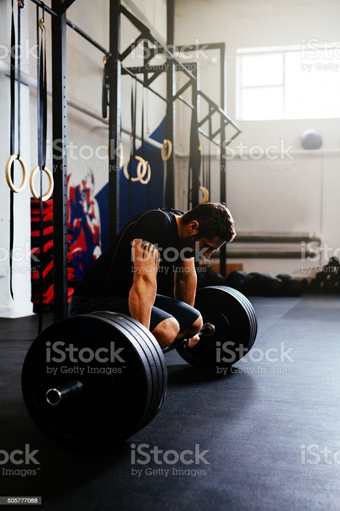 Tired athlete after deadlift exercise stock photo