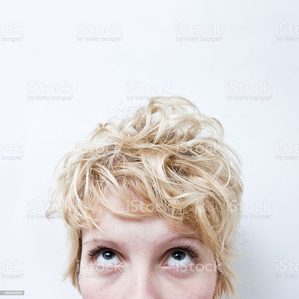Tired Blond Girl Looking Up stock photo