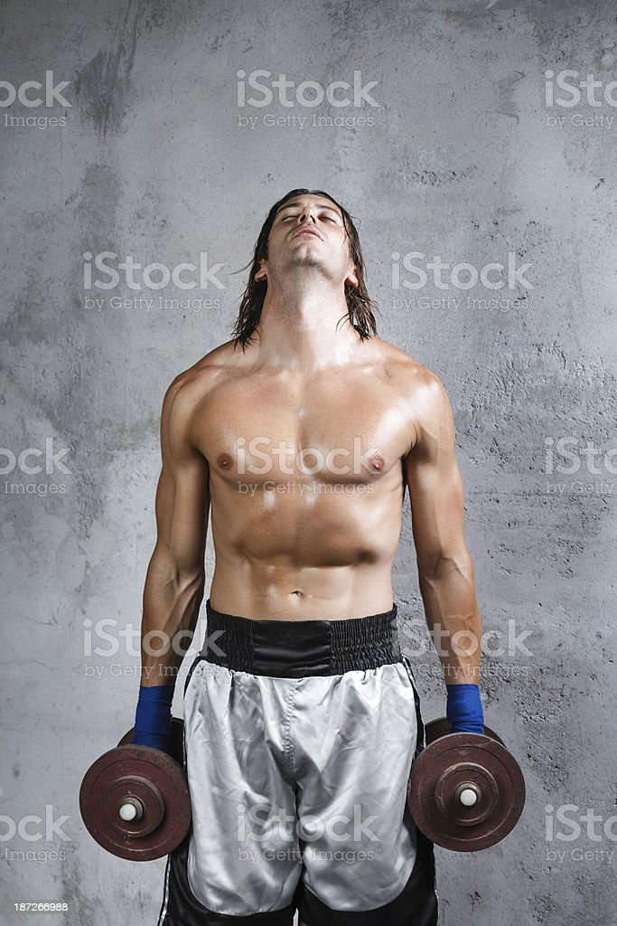 tired boxer resting from work out royalty-free stock photo