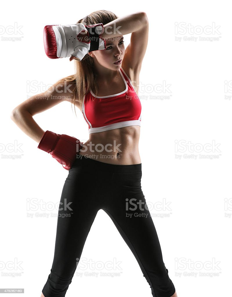 Tired brunette with boxing gloves having rest after workout stock photo