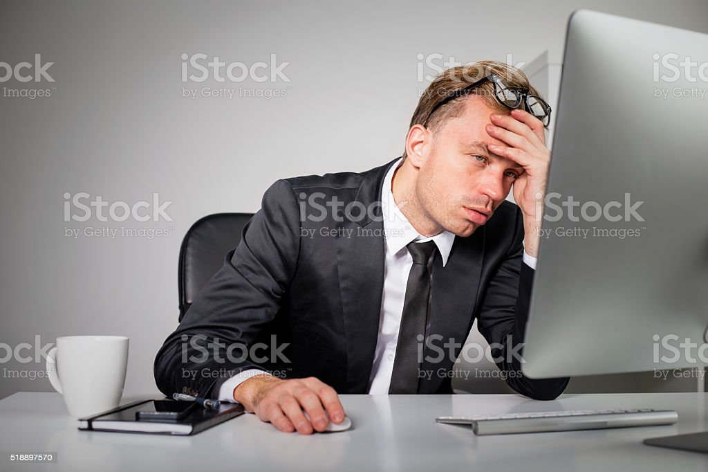 Tired business man at the office stock photo