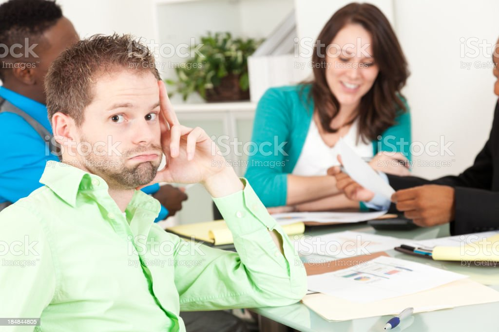 Tired businessman in an office business meeting stock photo