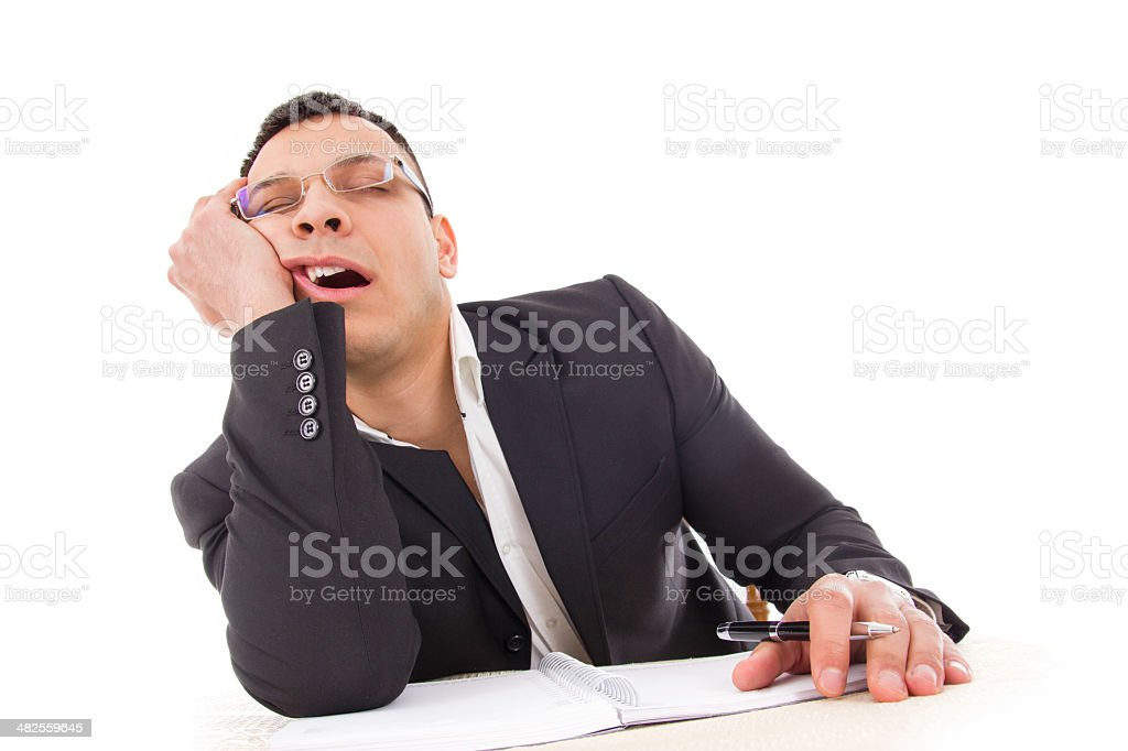 tired businessman sleeping at work yawning stock photo