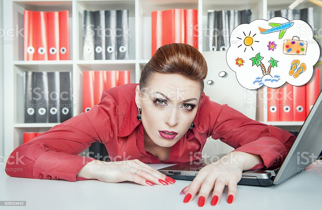 Tired businesswoman dreaming about holiday. Overwork concept stock photo