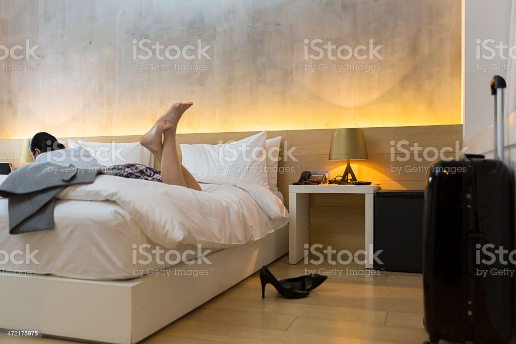 tired businesswoman on bed stock photo