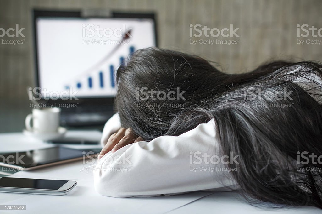 Tired businesswoman sleeping in office royalty-free stock photo