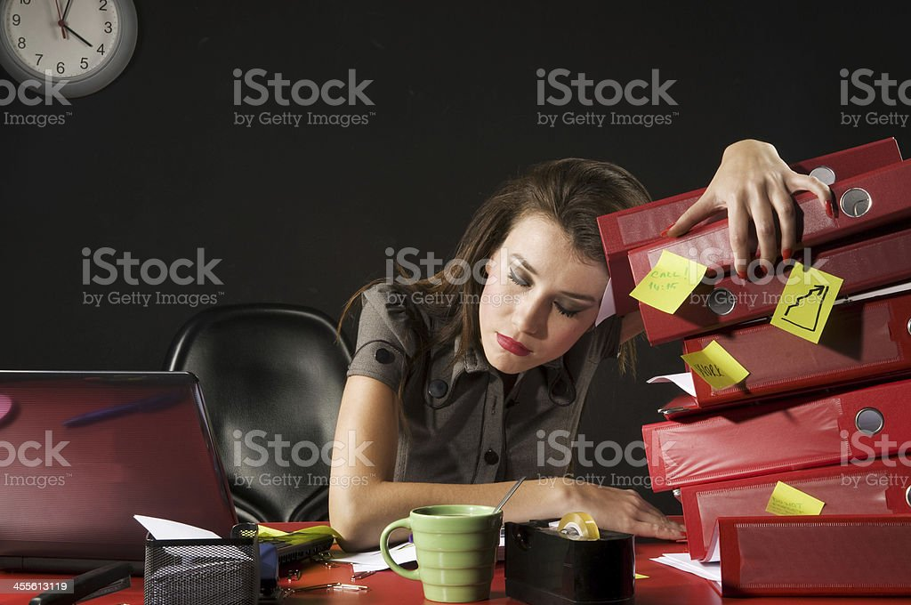 tired businesswoman sleeping royalty-free stock photo