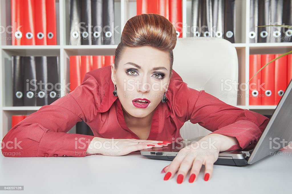 Tired businesswoman working in office. Overwork concept stock photo