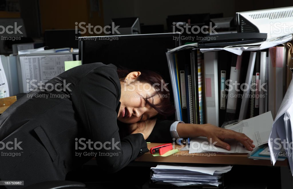 Tired Businesswoman Working Late royalty-free stock photo