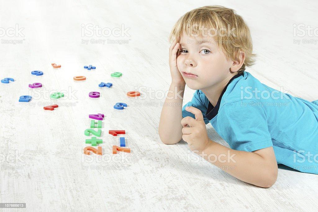 Tired child studying mathematics royalty-free stock photo