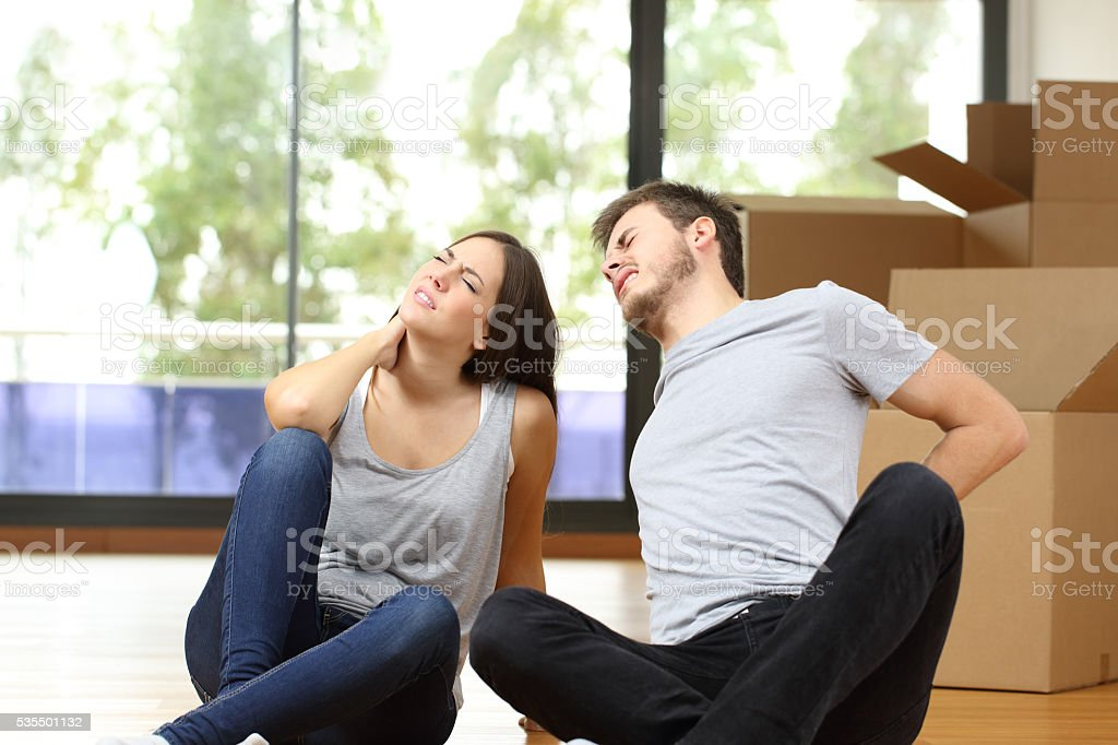 Tired couple moving home suffering stock photo