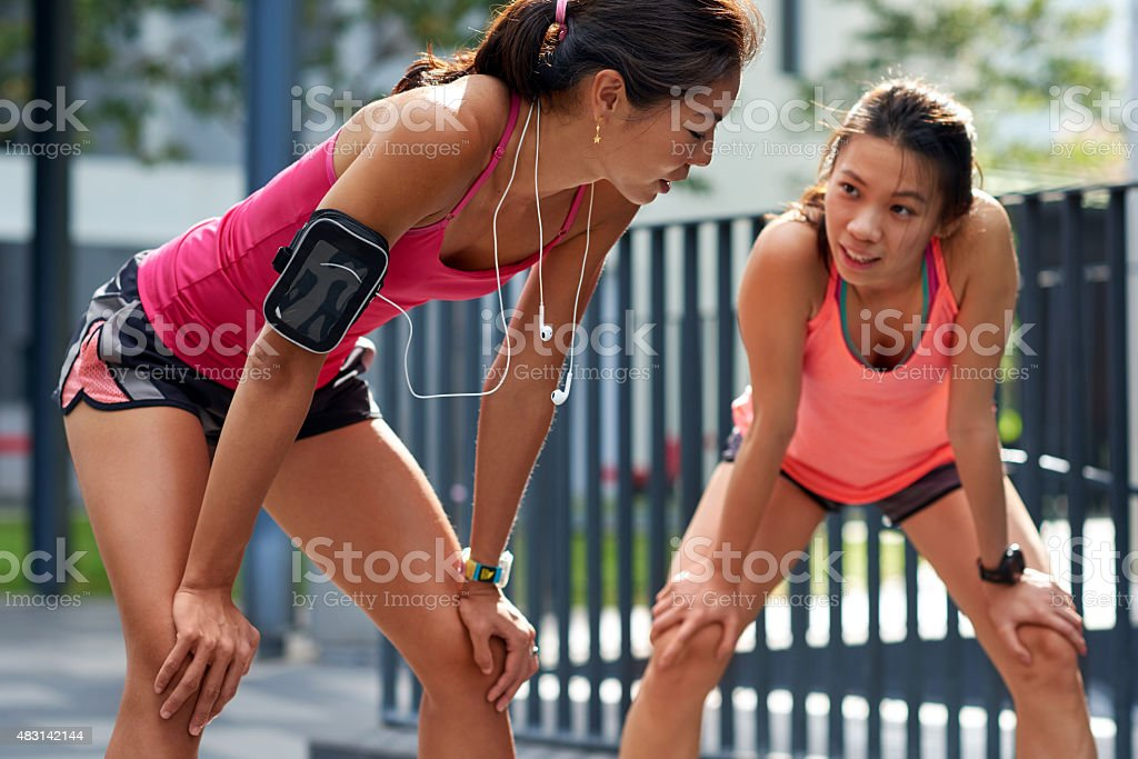 tired dehydrated runners stock photo