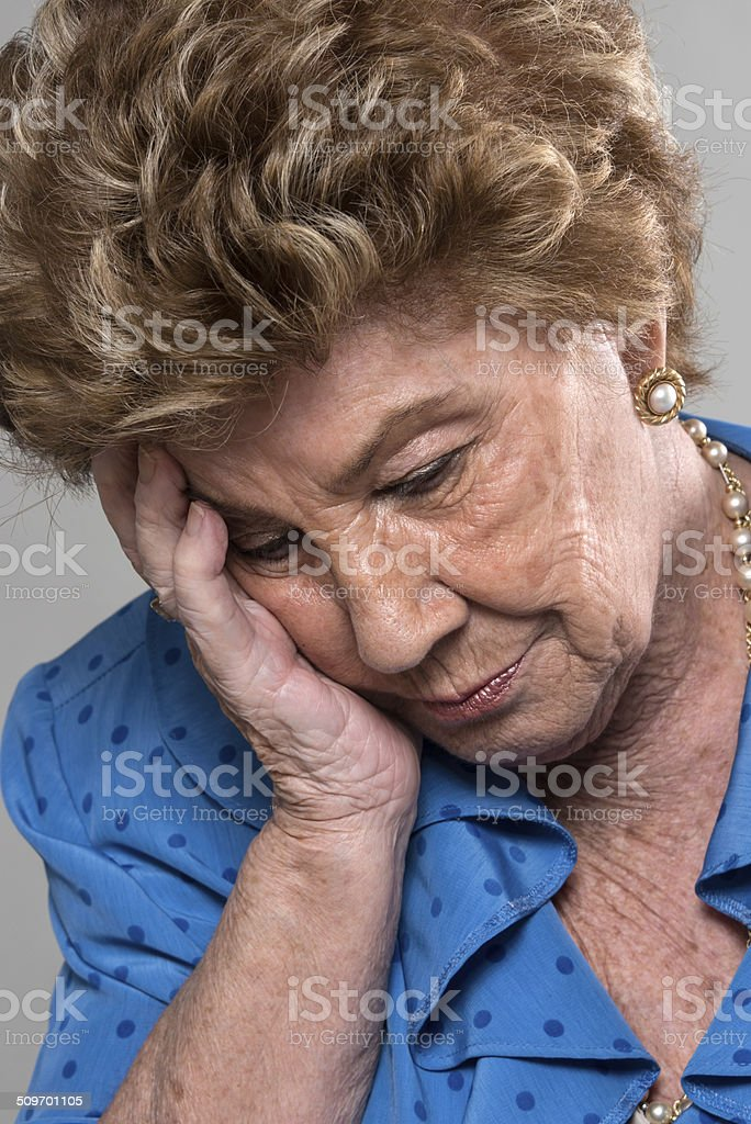 Tired eighty years old lady stock photo