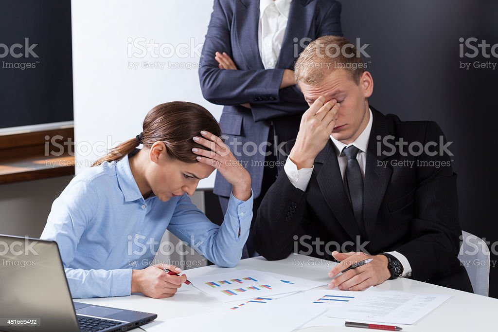 Tired employees during job stock photo