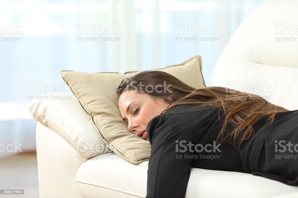 Tired executive sleeping at home after work stock photo