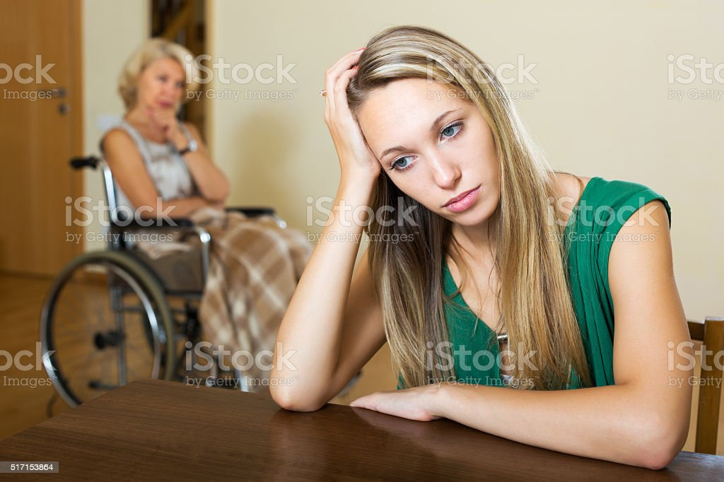 Tired female and disabled person stock photo