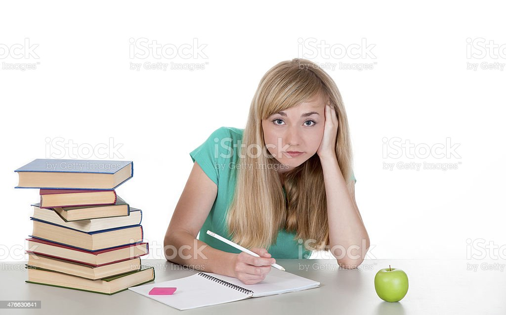 tired female student sits at table with books royalty-free stock photo