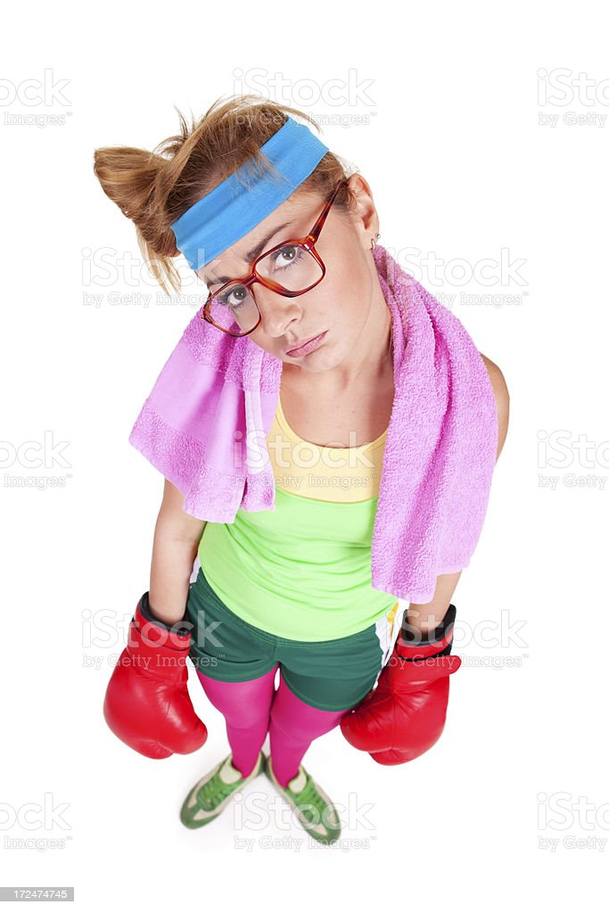 Tired funny female boxer posing with towel around neck royalty-free stock photo