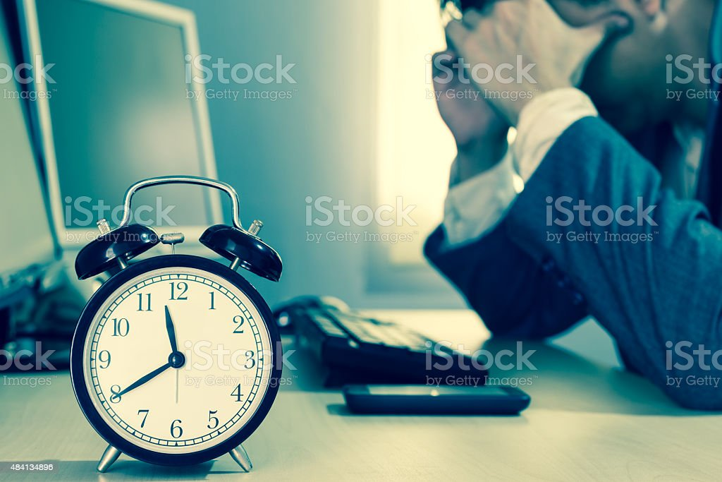 Tired & headache asian businessman work overtime stock photo