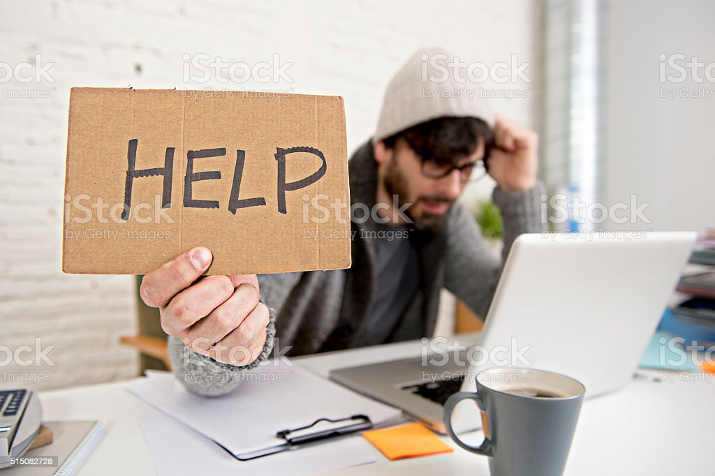 tired hispanic hipster businessman asking for help suffering work stress stock photo