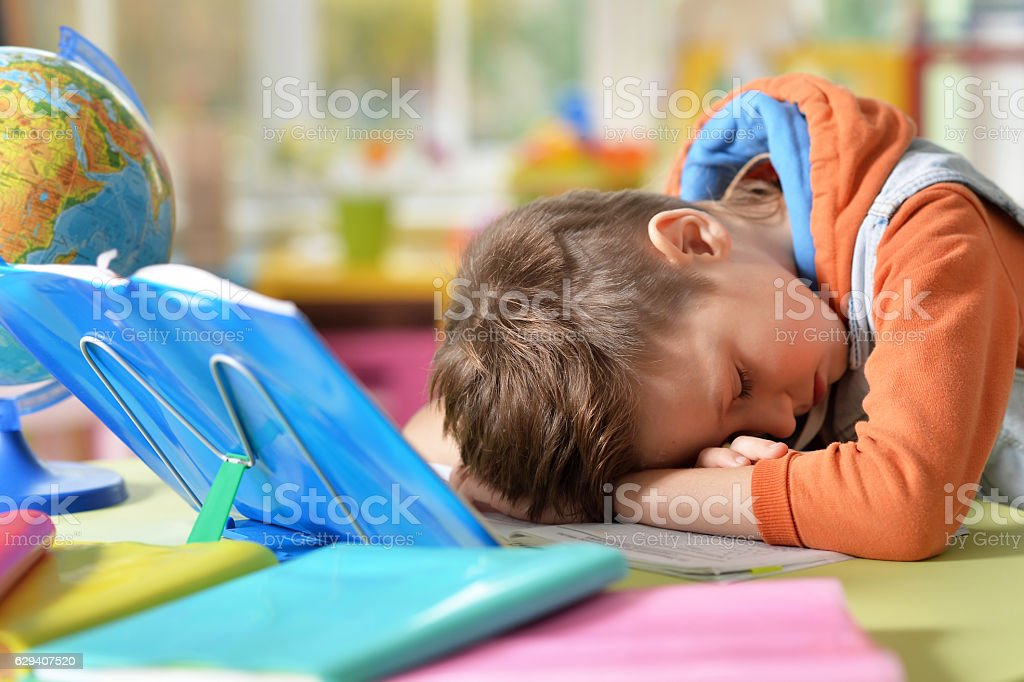 Tired little boy stock photo