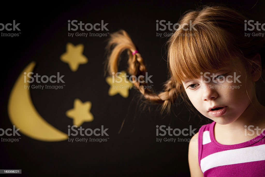 Tired Little Girl with Upward Braids By Moon and Stars stock photo