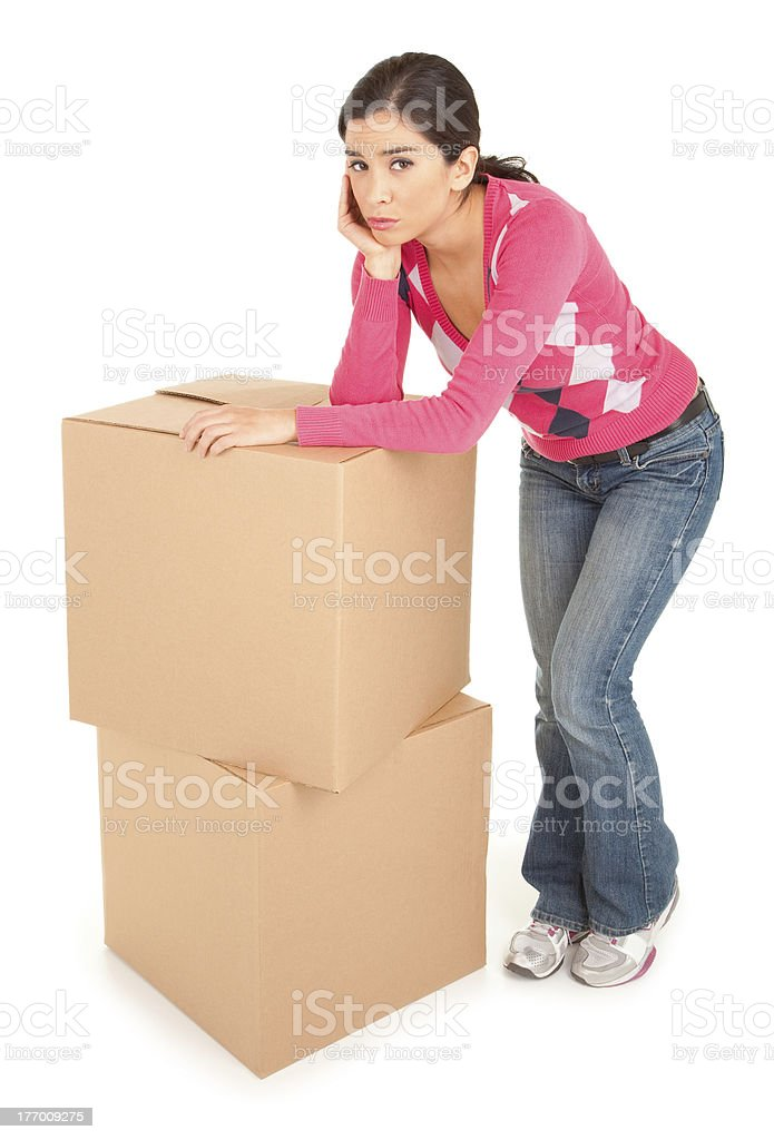 Tired Looking Woman Leaning on Boxes stock photo