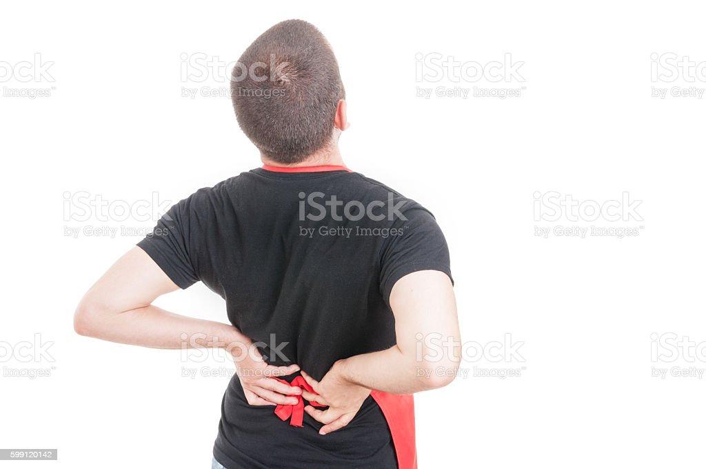 Tired male employee having lumbar pain stock photo