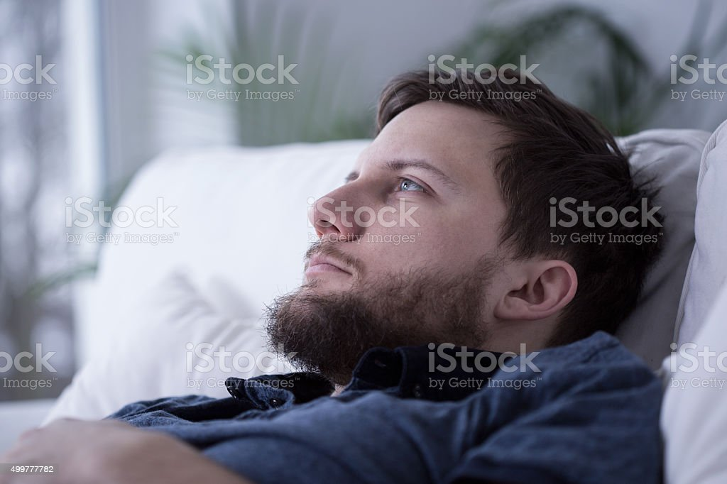 Tired male unable to fall asleep stock photo