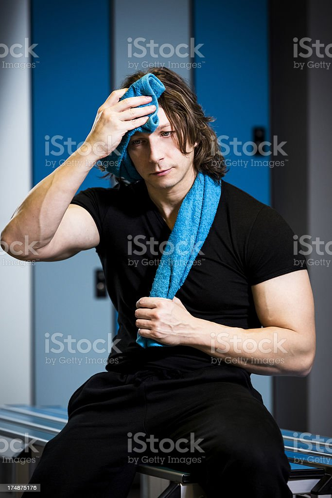 Tired man after exercise in a Gym royalty-free stock photo