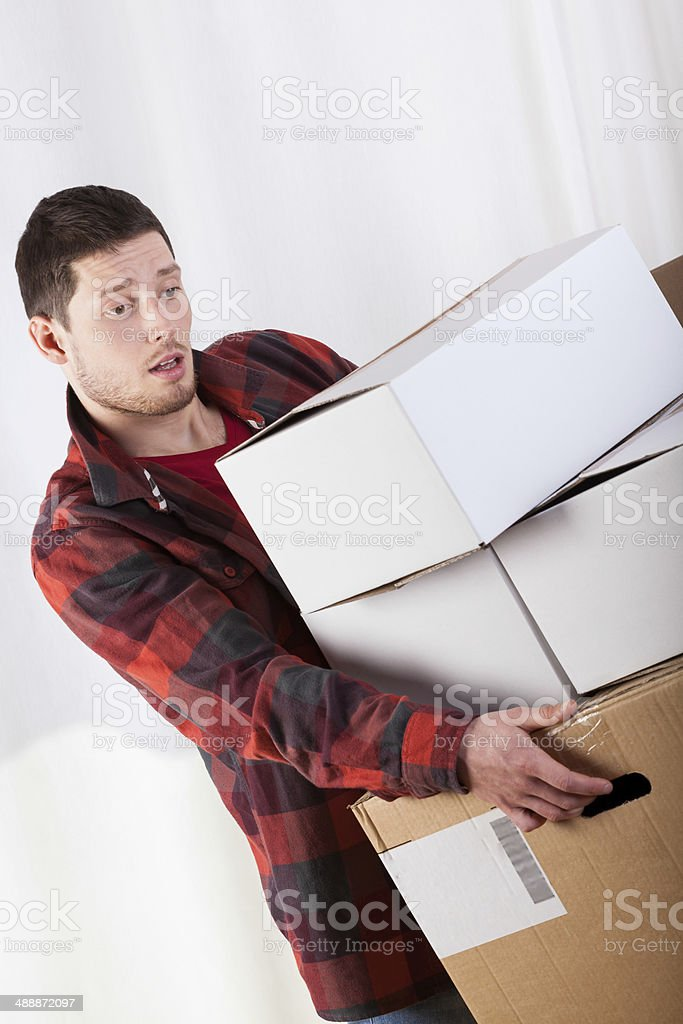 Tired man during moving house stock photo