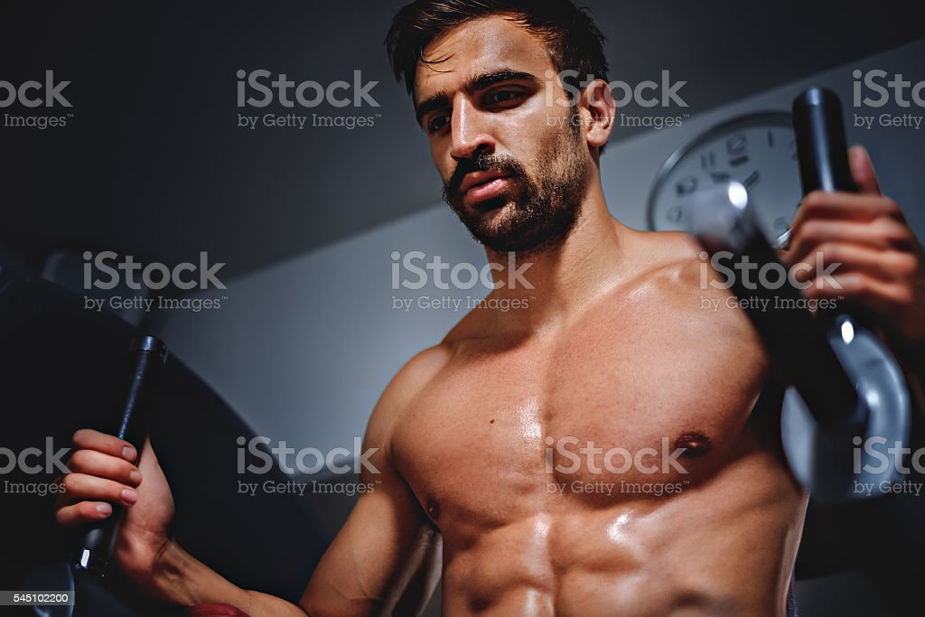 Tired man in the gym looking down stock photo