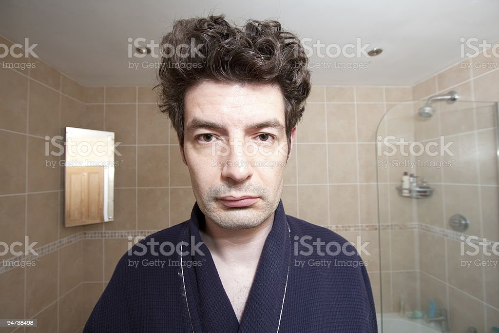 Tired Man Looking in the Mirror stock photo